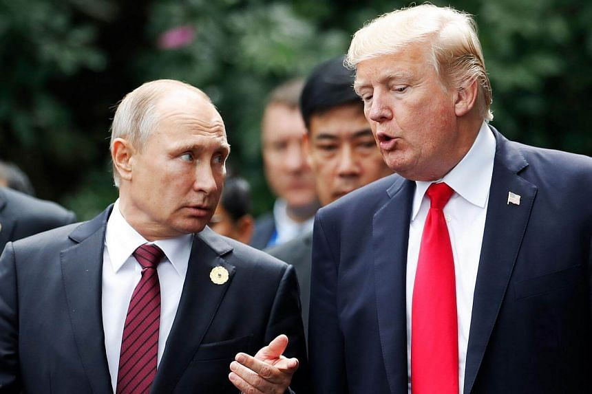 US President Donald Trump (right) and Russia's President Vladimir Putin talk during the Asia-Pacific Economic Cooperation leaders' summit in Vietnam on Nov 11, 2017. 13 Russians have been indicted for meddling in the 2016 presidential election.