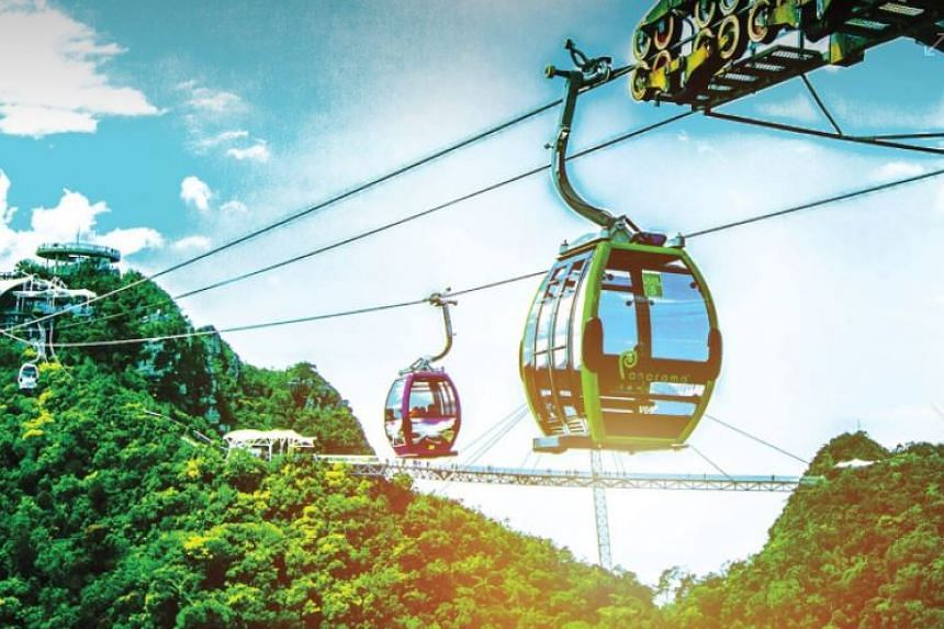 The technical glitch occurred after 6pm as visitors were queueing to make the trip down from the peak of Gunung Machinchang in Langkawi. PHOTO: FACEBOOK/LANGKAWI SKYCAB