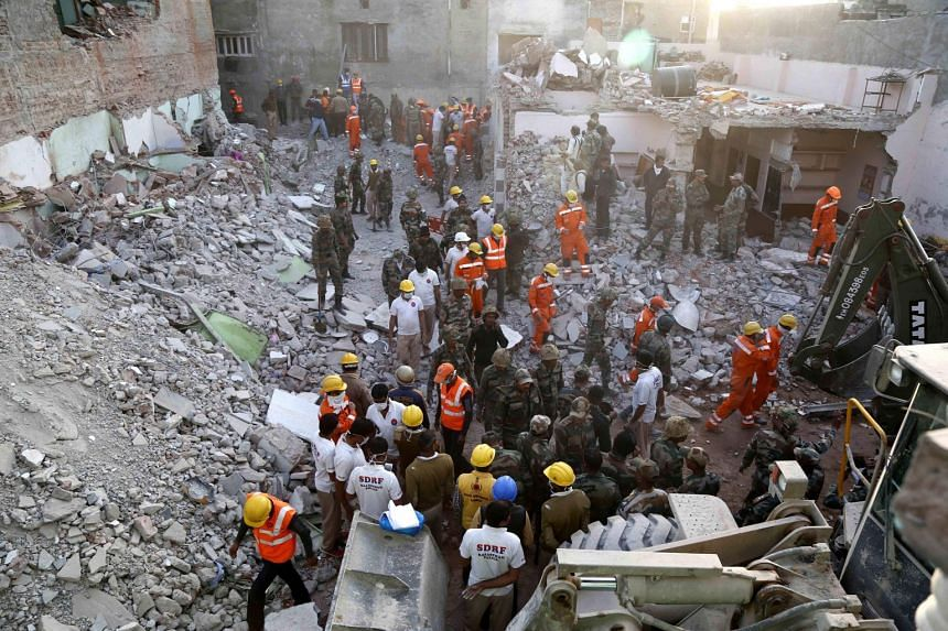 Indian army and emergency services personnel carrying out rescue work after a building collapsed because of a gas cylinder explosion during a wedding party in Beawar, Rajasthan state, on Feb 18, 2018.