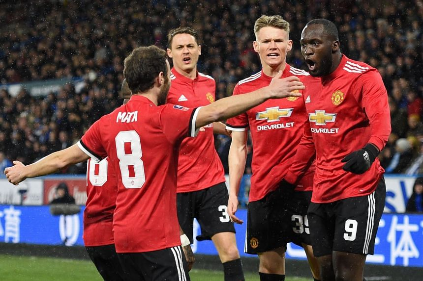 Lukaku (right) celebrates with team mates after scoring the opening goal.