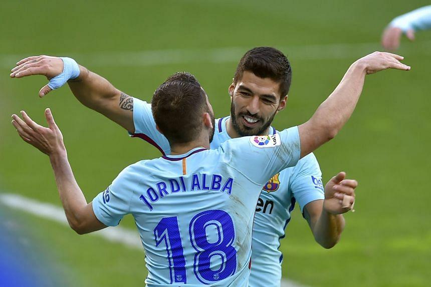 Jordi Alba is congratulated by Luis Suarez for scoring Barcelona's second goal.