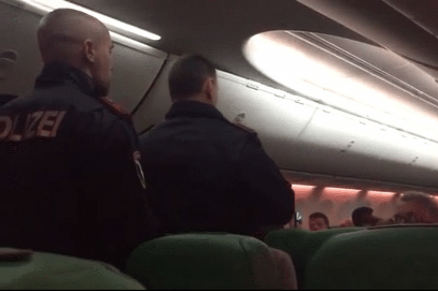 Austrian police officers on board the aircraft, after the plane made an unscheduled stop in Vienna International Airport after a fight broke out.