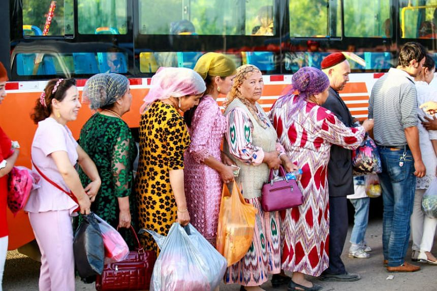 People queueing to take a bus in Aksu in Xinjiang Autonomous Region. The far-western Chinese region is planning a poverty relief scheme for the region's 22 poorest counties, which include some in Aksu prefecture.