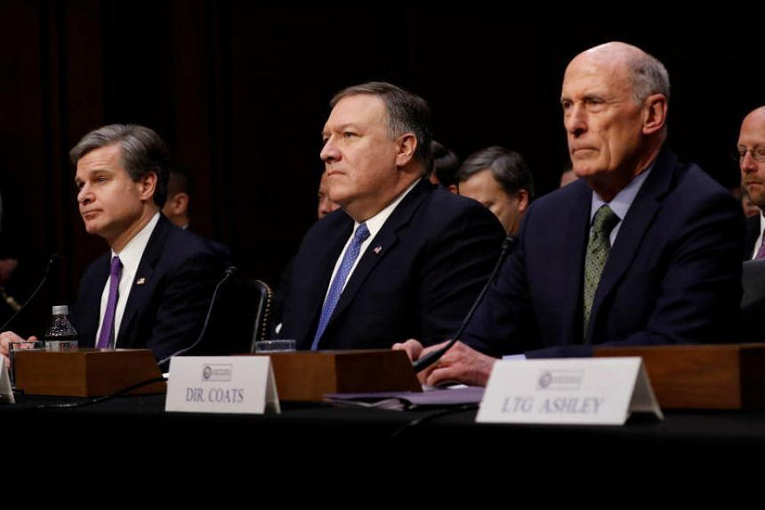 (From left) FBI director Christopher Wray, CIA director Mike Pompeo and the director of National Intelligence Dan Coats waiting to testify before the Senate Intelligence Committee in Washington on Feb 13, 2018.