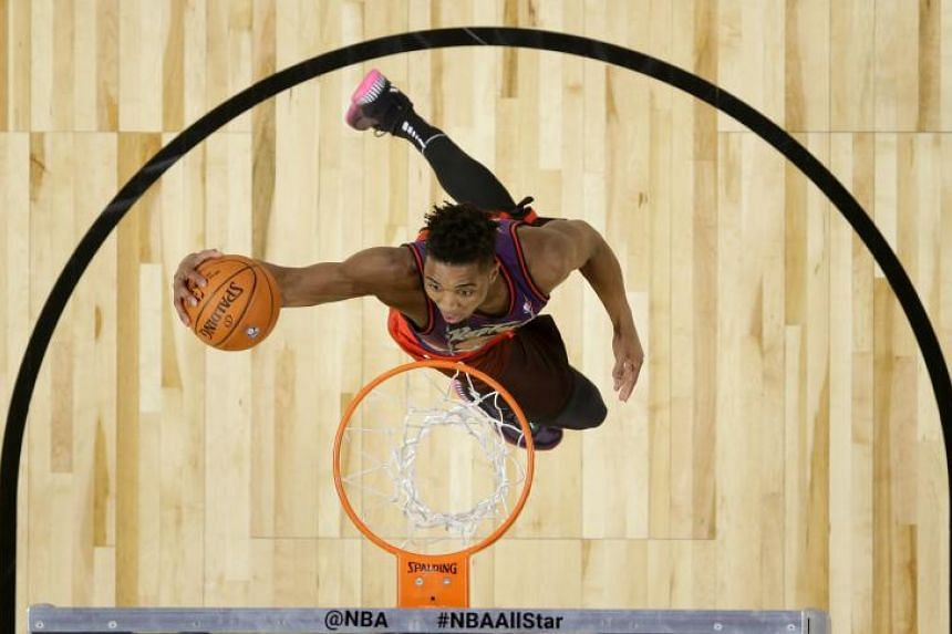 Utah Jazz guard Donovan Mitchell going up for his final dunk during the NBA Slam Dunk contest, on Feb 17, 2018.
