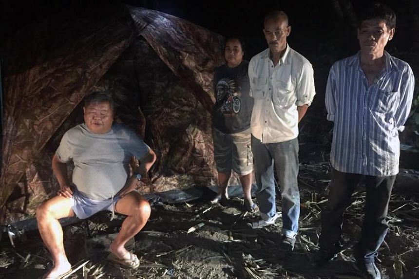 Thai construction tycoon Premchai Karnasuta (left) and three other suspects after being arrested by park rangers in Thungyai Naresuan Wildlife Sanctuary in Kanchanaburi province, on Feb 4, 2018.