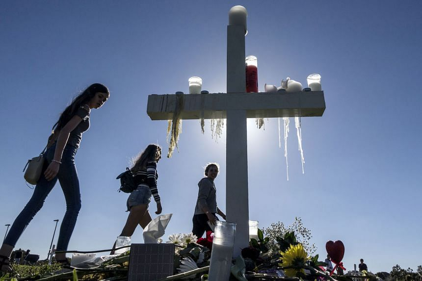 People visiting a temporary memorial in Parkland, Florida, last Friday, for the victims of the mass shooting at Marjory Stoneman Douglas High School that left 17 dead. Anger over the attack intensified after the FBI said that information it had recei
