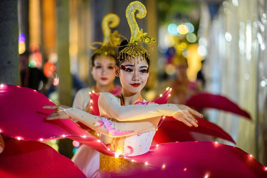 HONG KONG:Performers warming up for a street parade on the eve of the new year.