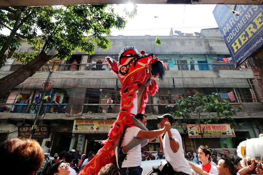 The Chinese community taking part in a lion dance during the Chinese New Year celebrations in Kolkata on Friday.