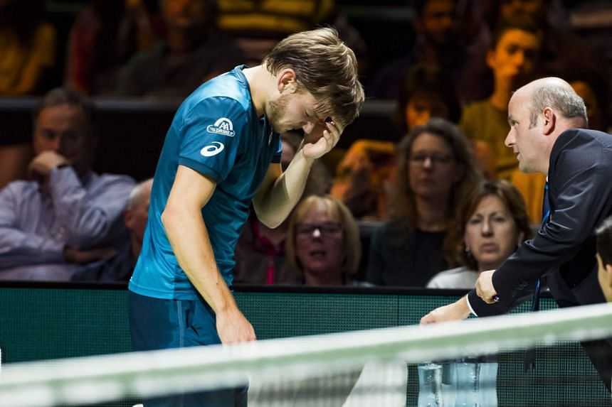 Goffin reacts after an injury during his semi-final singles match.