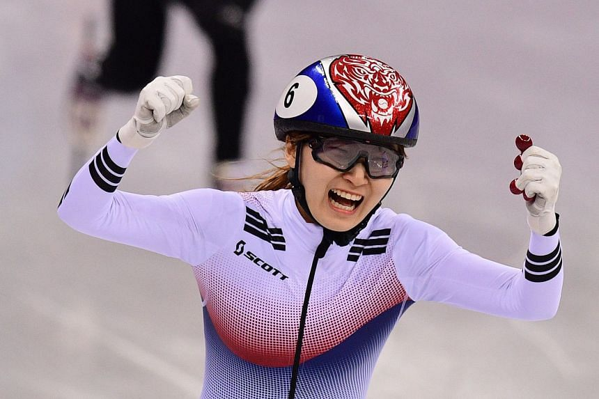 Choi celebrates her win in the women's 1,500m short track speed skating.