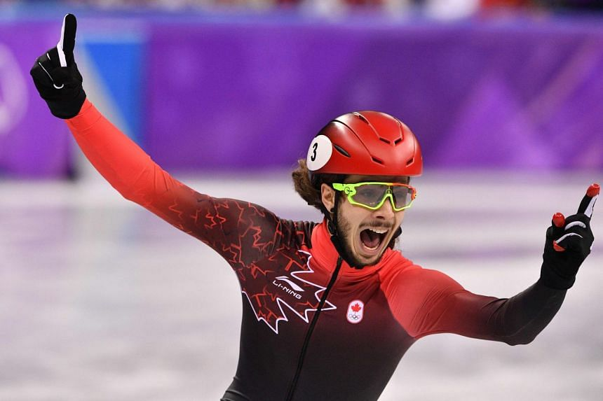 Girard celebrates his gold win in the men's 1,000m short-track speed skating.