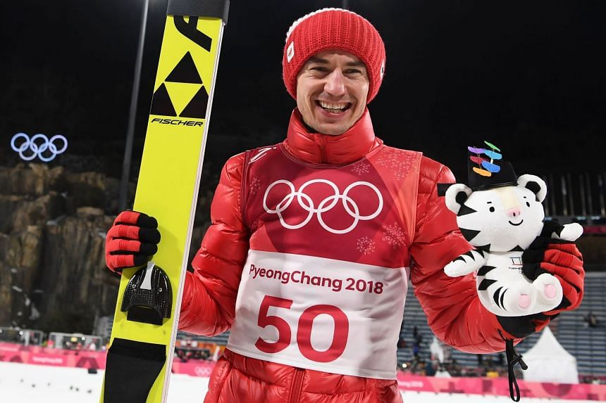 Stoch pose for a picture after the victory ceremony.