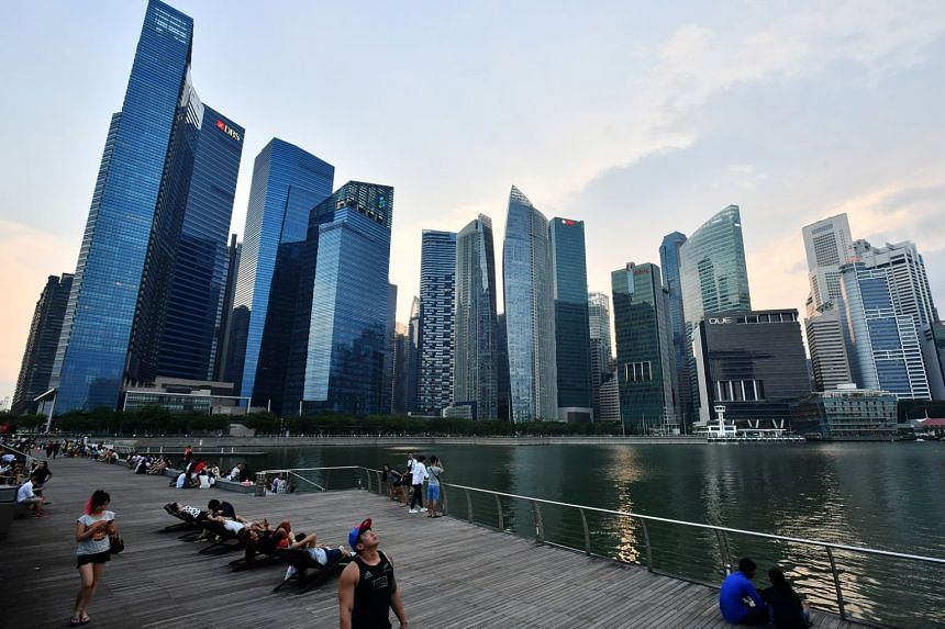 People walk along the Marina Bay Waterfront Promenade