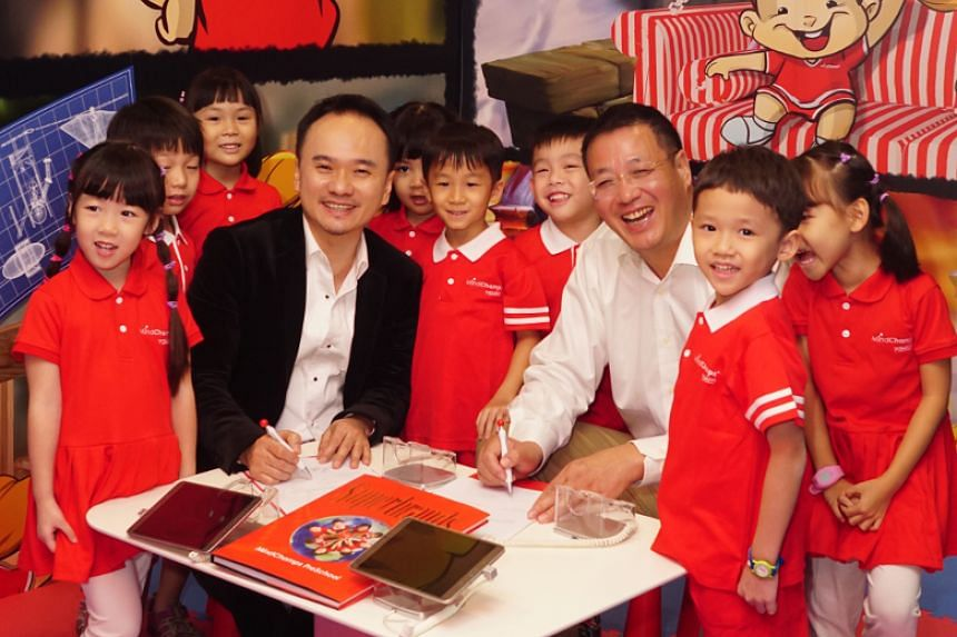 MindChamps PreSchool chief executive David Chiem (left) and China First Capital Group chairman Wilson Sea. MindChamps and CFCG will incorporate a new company, which will be appointed the master franchisee in China.