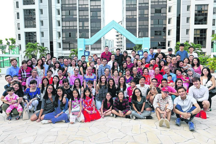 Over 90 members of three generations of the Thia extended family gathered at Amber Point condominium yesterday for their Chinese New Year celebration. Three large tables were used for their lo hei - the tossing of raw fish salad for good fortune. The