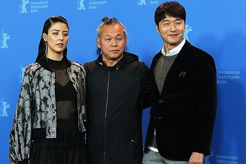South Korean director Kim Ki Duk (centre) with Japanese actress Mina Fujii and South Korean actor Lee Sung Jae, from his film Human, Space, Time And Human, in Berlin.