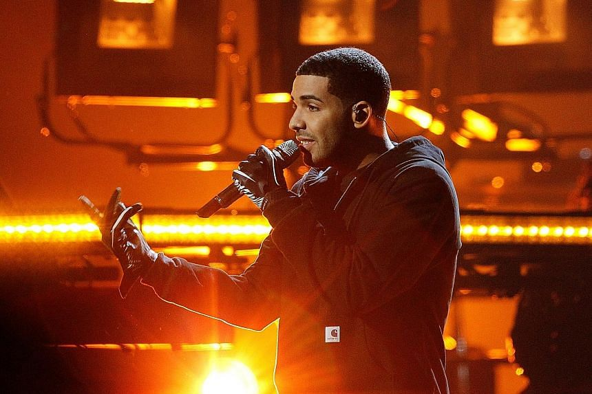 The music video for God's Plan showed singer Drake (above, in a 2011 photograph) giving money to struggling families, among other people, in Miami.
