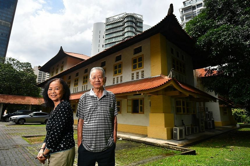 Ms Angela Liong and Mr Adrian Lim on the premises of 126 Cairnhill Road. They are hoping the building, built in 1925, can be gazetted for conservation.