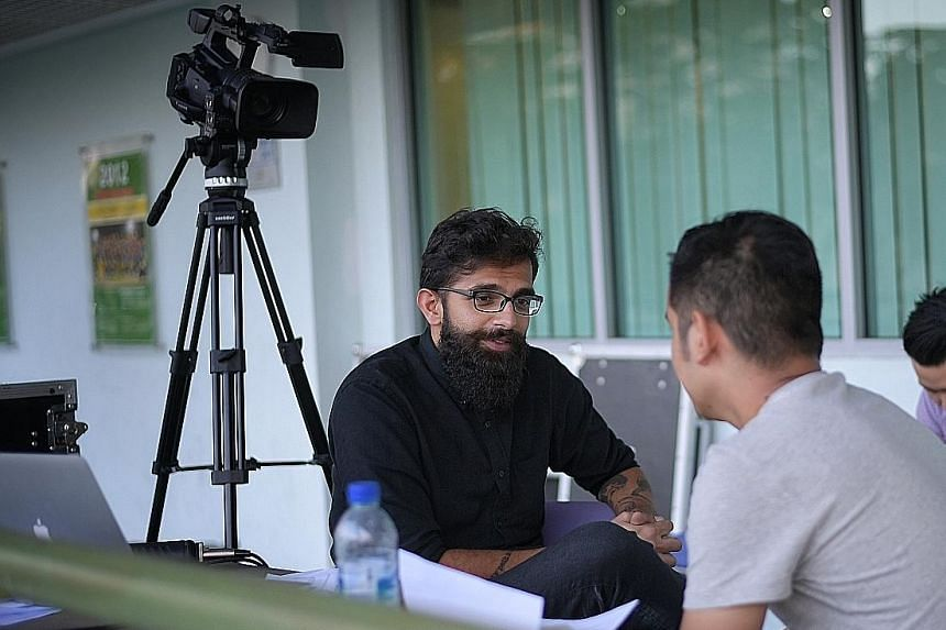 Farez Juraimi (right), a criminology student at the Singapore Institute of Technology, during his audition with FAS marketing manager Ravi Maan at the Jalan Besar Stadium last week. The FAS' plan is to assemble a pool of up to 20 announcers.