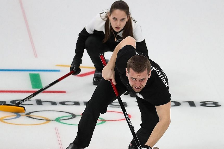 Alexander Krushelnitsky and his wife, Anastasia Bryzgalova, on their way to winning a curling bronze in the play-off against Norway on Feb 13.