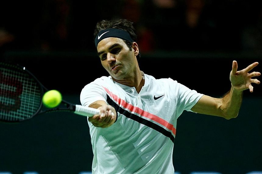 Roger Federer hitting a forehand en route to a 6-2, 6-2 victory over Bulgarian Grigor Dimitrov for his third Rotterdam Open title yesterday. He claimed his 97th career title in just 55 minutes, capping off a memorable week. The 36-year-old Swiss will