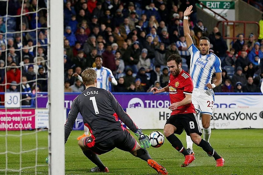 Juan Mata rounding Huddersfield goalkeeper Jonas Lossl before slotting home as defender Mathias Zanka appeals for offside. The call eventually went the way of the hosts but to little avail, as United ran out 2-0 winners in the FA Cup fifth-round tie