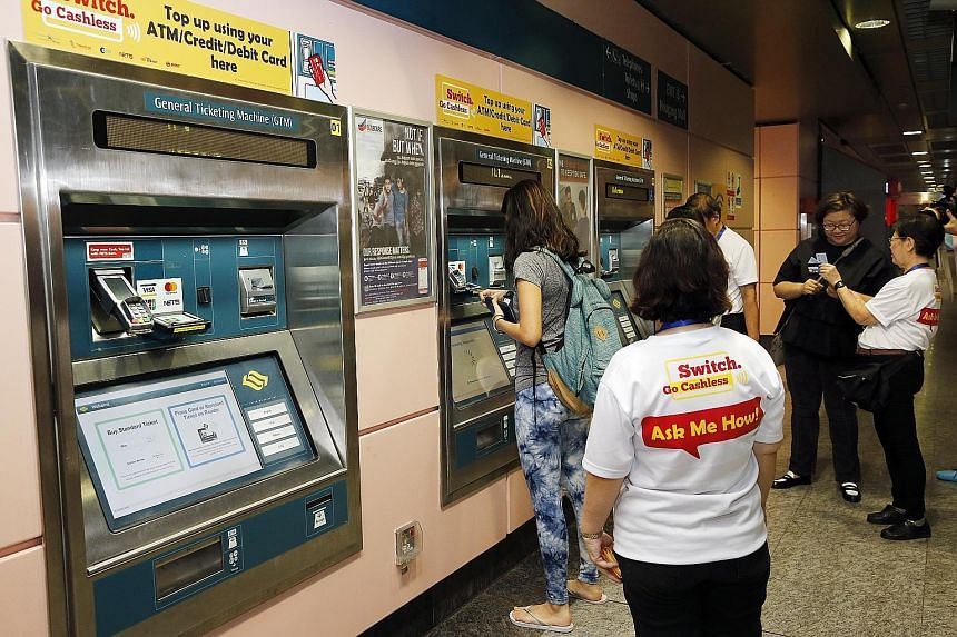 A service agent standing by to guide commuters in topping up their ez-link cards using ticketing machines at Hougang MRT station in September last year.