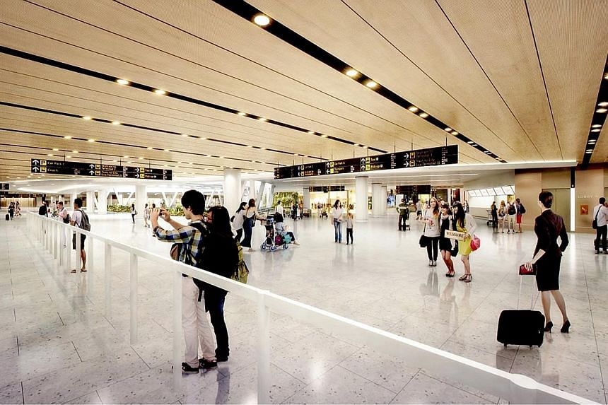 """An artist's impression of the new """"meeters and greeters hall"""" at Changi Airport Terminal 1 that will open progressively from April. It will lead to a 35 per cent expansion in the floor area of T1's arrival hall."""