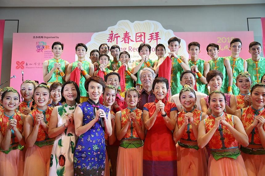 Deputy Prime Minister Teo Chee Hean (centre) with performers from River Valley High School's Dance Society at the Singapore Chinese Cultural Centre yesterday. With him were MacPherson MP Tin Pei Ling; Fengshan MP Cheryl Chan; Senior Parliamentary Sec