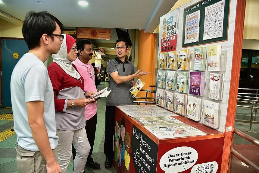 Mr Dennis Chee speaking to fellow workgroup members (from left) Andy Chan, Norazizah Mohd Tajudin and Perumal Moorthy about a PA initiative at Bukit Panjang Community Club.