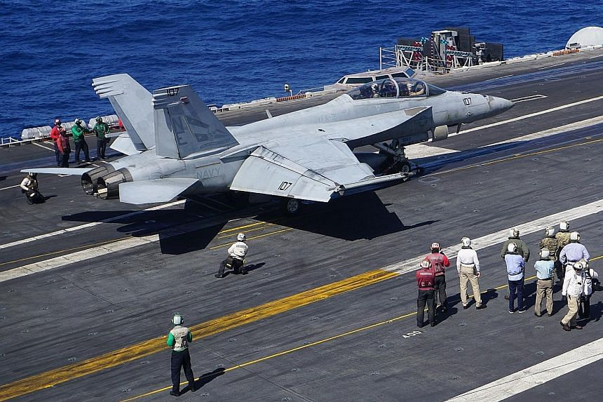An F-18 Hornet fighter jet set for take-off from the flight deck of aircraft carrier USS Carl Vinson during a routine deployment in the South China Sea this month. The writer believes that while the US still has an overall military advantage over Chi