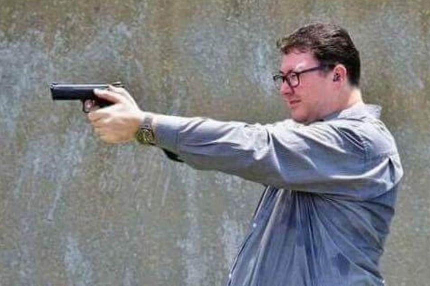"""George Christensen put up an image showing him in a shooting stance with the comment """"You gotta ask yourself, do you feel lucky, greenie punks?""""."""