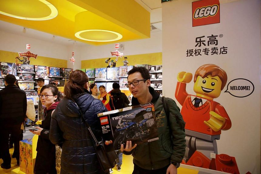 A customer carries a Lego set at a store in Beijing, China, on Jan 13, 2018.