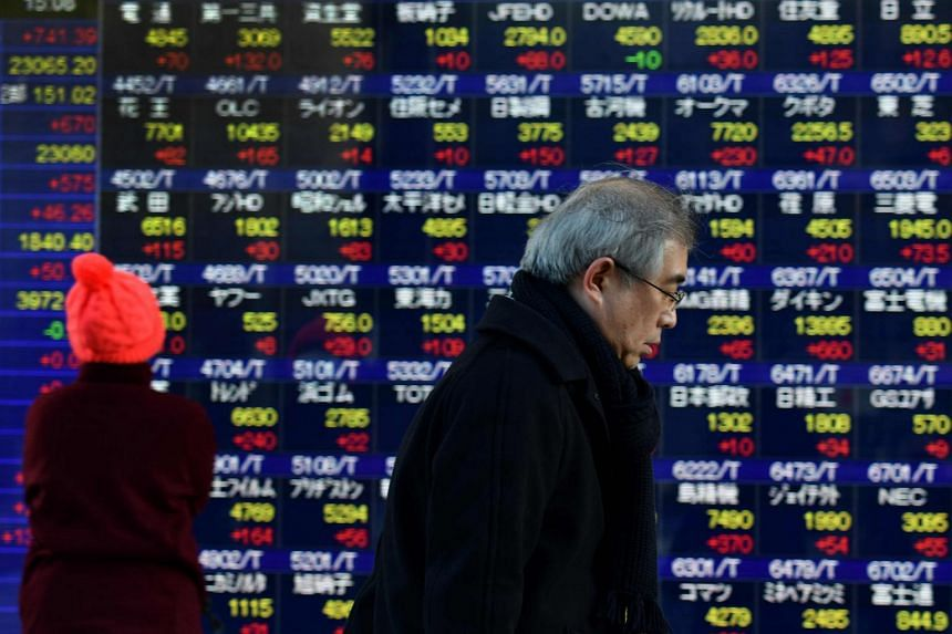 Tokyo followed Wall Street's narrowly positive close, with the benchmark Nikkei 225 index up 1.33 per cent, or 288.76 points, to 22,009.01 at the break.