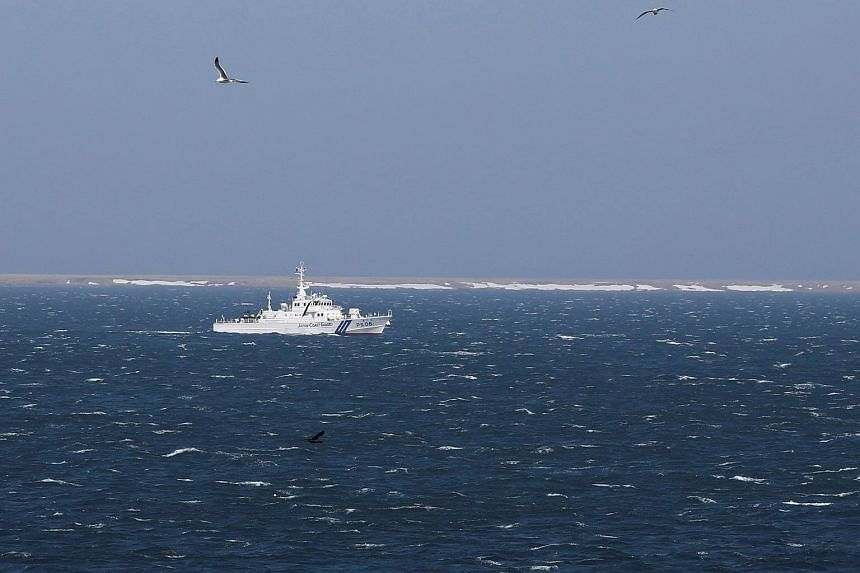 A Japanese coast guard vessel sails off Cape Nosappu, easternmost point in Japan, in Nemuro on Hokkaido island, as part of a group of islands known as the Northern Territories in Japan and the Southern Kuriles in Russia.