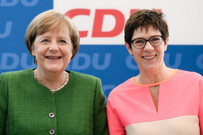 German Chancellor Angela Merkel and Saarland premier Annegret Kramp-Karrenbauer posing for the media ahead of a board meeting at the Christian Democratic Union headquarters in Berlin on Feb 19, 2018.
