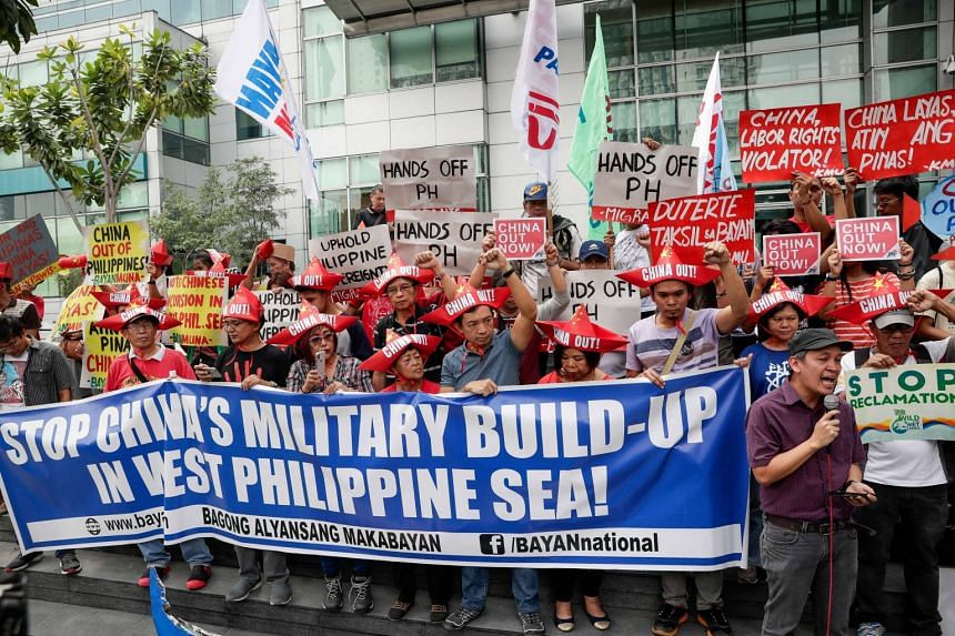 Activists shouting slogans outside the Chinese Embassy in Makati City in the Philippines, on Feb 10, 2018.