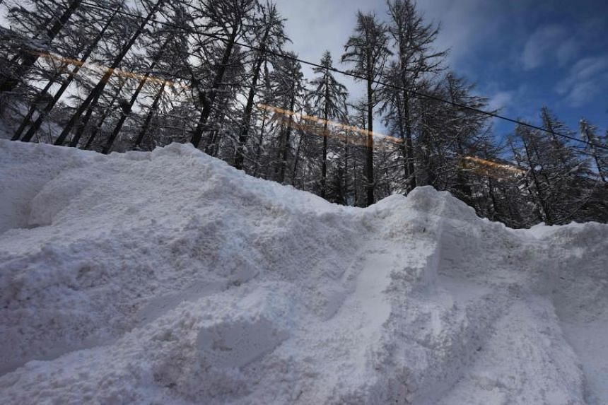 The Zermatt to Tasch train passes by the scene of an avalanche, as train services resumed to evacuate tourists after heavy snowfall and avalanches had trapped more than 13,000 at Zermatt, which is one of Switzerland's most popular ski stations on Jan