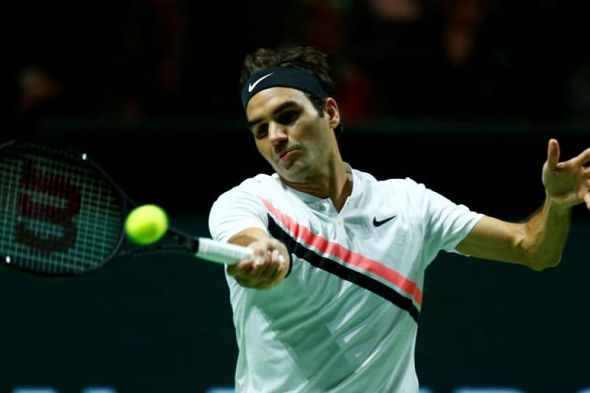 Roger Federer of Switzerland is seen in action against Grigor Dimitrov of Bulgaria at the Rotterdam Open on Feb 18, 2018.
