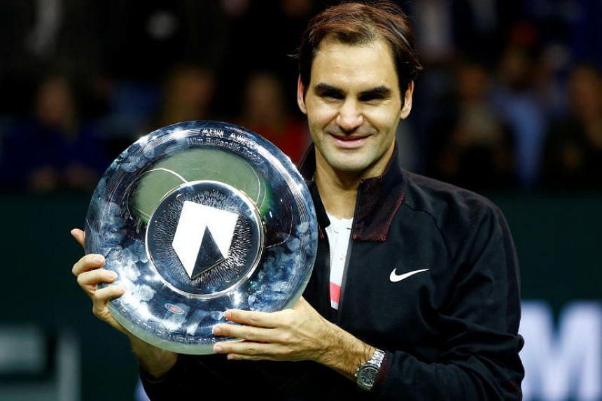 Roger Federer of Switzerland holds the trophy after winning the Rotterdam Open on Feb 18, 2018.