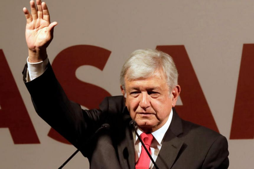 Andres Manuel Lopez Obrador gestures after being sworn-in as presidential candidate of the National Regeneration Movement (MORENA) during the party's convention at a hotel in Mexico City, Mexico on Feb 18, 2018.