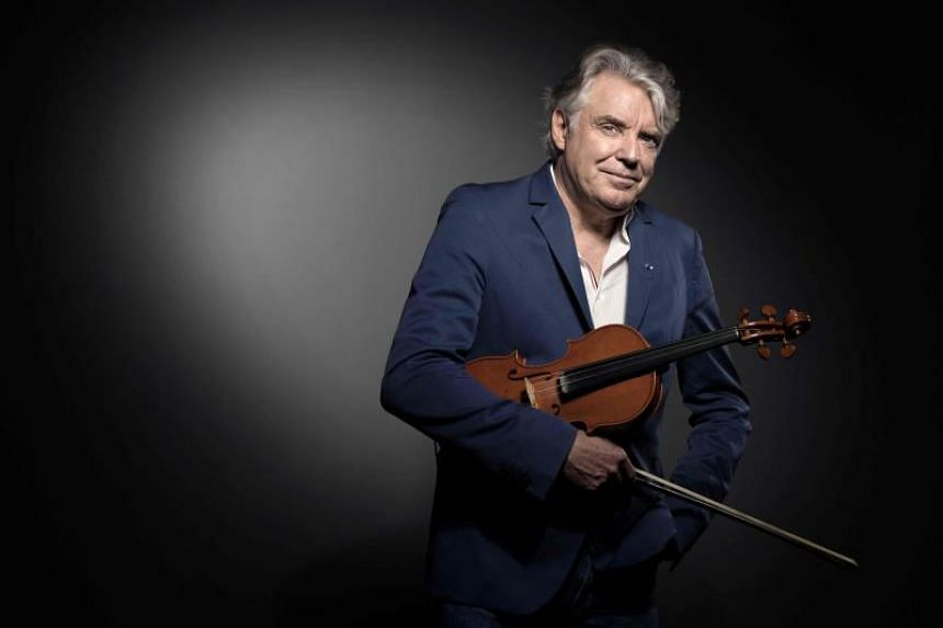 French composer and jazz violinist Didier Lockwood poses during a photo session in Paris in this file photo taken on May 31, 2017.