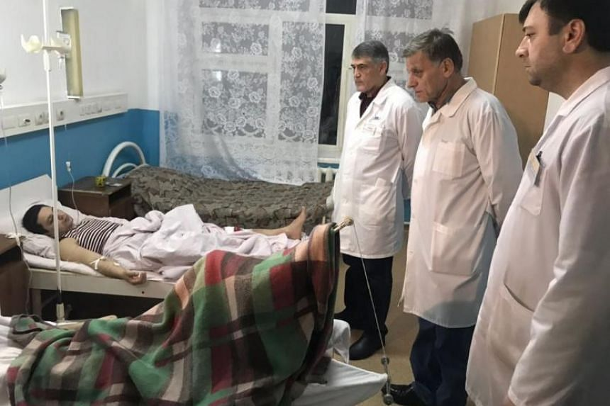 Doctors examine a wounded man in the hospital after a shooting near the church in Kizlyar Dagestan, Russia, on Feb18, 2018.
