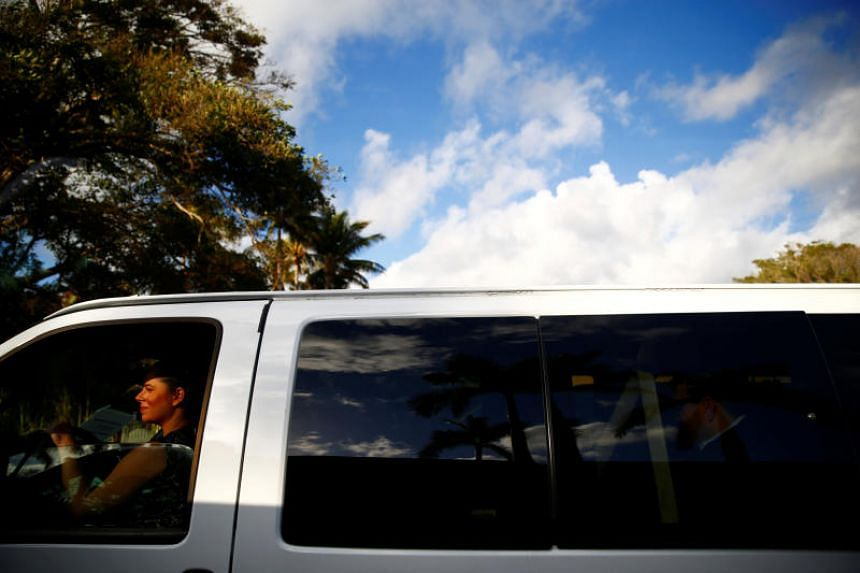 A White House staff member is seen in a press van at US President Donald Trump's Mar-a-Lago estate in Palm Beach, Florida, US on Feb 19, 2018.