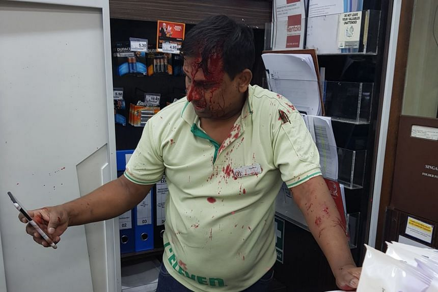 The employee was left with blood streaming down his face and a blood-spattered work polo shirt after the assault.