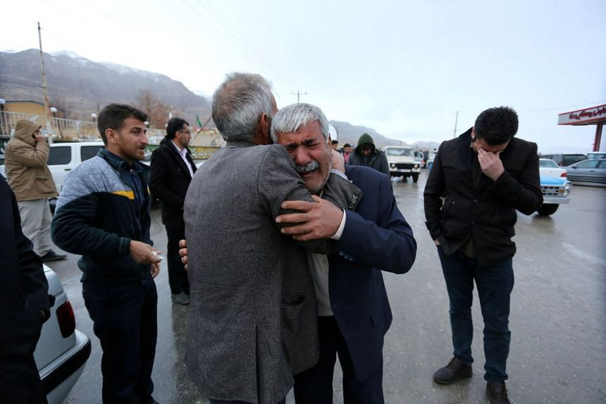 Relatives of passengers who were believed to have been killed in a plane crash near the town of Semirom in Iran on Feb 18, 2018.