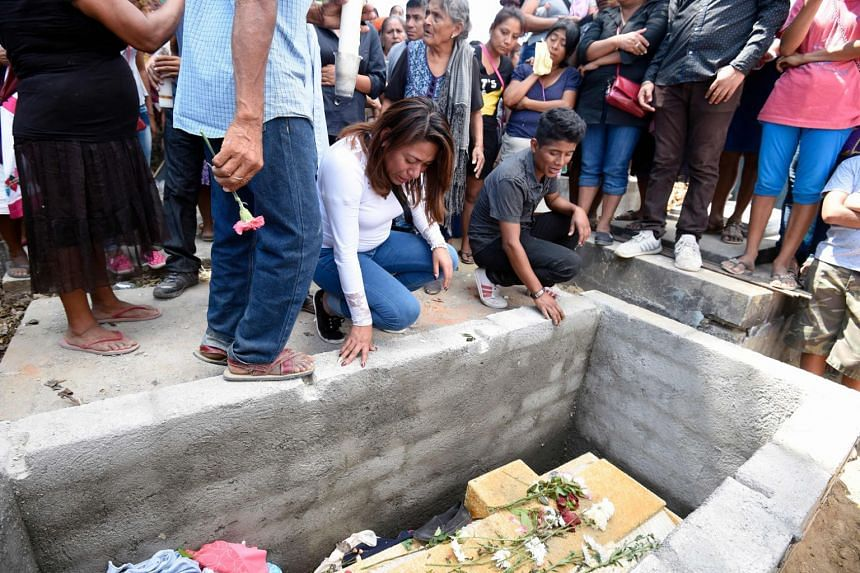 Relatives and friends of 13 people killed when a military helicopter fell on a van in Santiago Jamiltepec, Mexico, attend the funeral of one of the victims on Feb 18, 2018.
