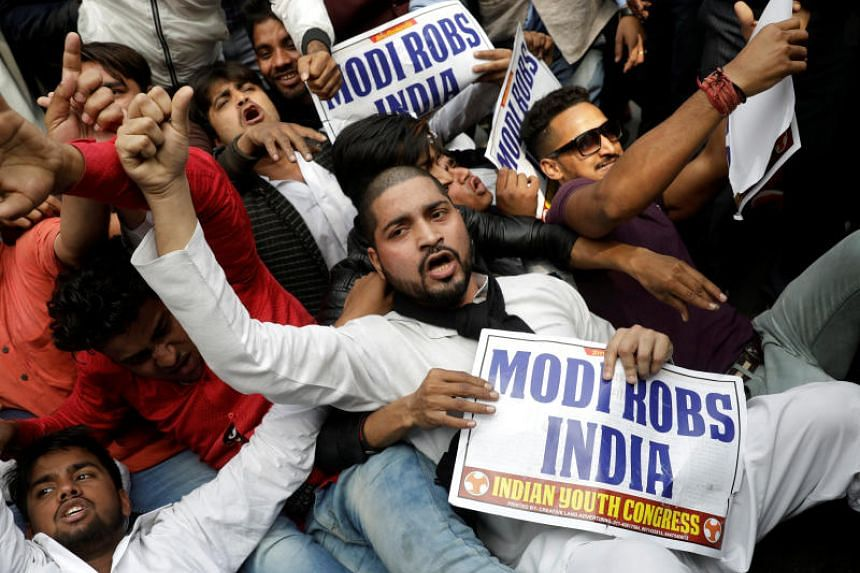 Activists of the youth wing of India's main opposition Congress party protest against billionaire jeweller Nirav Modi in New Delhi on Feb 16, 2018.