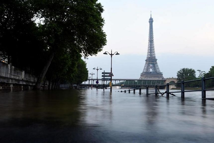Scientists predict higher frequencies of floods, famines and superstorms unless the world keeps temperature rises well below 2 degrees Celsius this century.